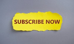 SUBSCRIBE NOW text written on yellow torn paper.Conceptual hand writing showing Subscribe Now. Business photo text to pay money to an organization in order to receive a service.