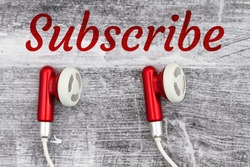 Subscribe word message with earbuds red and white on black grunge wood