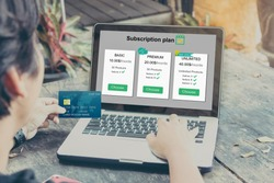 Subscription business model concepts.Man hands holding credit card and using laptop or pc