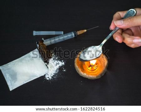 Substance abuse with Ketamine,  candle, syringe