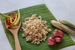 subterranean ant egg put on banana leaf with herb ingredient for cook Esan food, Lao food (local food)
