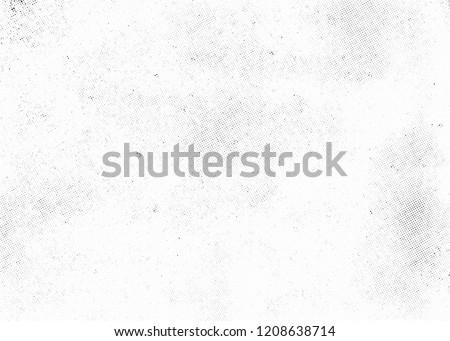 Subtle halftone texture overlay. Monochrome abstract splattered background.