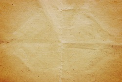 Subtle old folded brown recycled paper as background