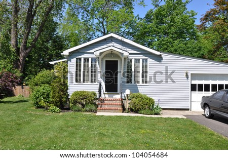 Suburban Cottage Home Light Blue Aluminum Siding Sunny Spring Day Morning