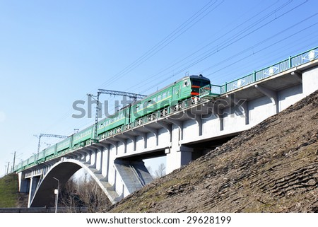 Suburban electric train drive on the brige - stock photo