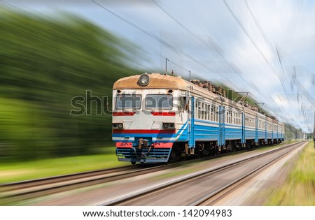 Suburban electric train on a blurred background