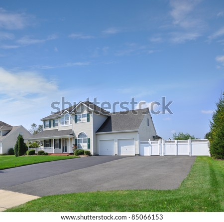 Suburban extra wide blacktop driveway of luxury two story for Two story double wide