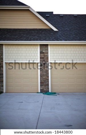 Suburban garage doors indicating at least a two car garage typical expectations of a \