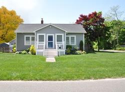 Suburban Gray Bungalow style home Autumn Season USA