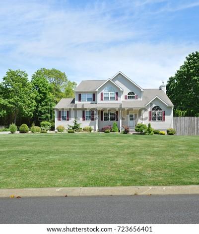 Suburban Gray McMansion Home USA #723656401