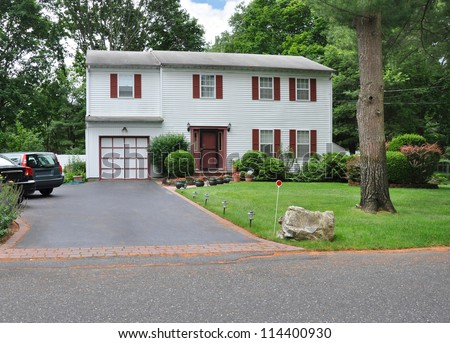 Suburban High Ranch House Blacktop Driveway in residential neighborhood