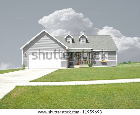 Suburban Home - A gray vinyl siding home on a gray day.  Only the grass lawn has color.