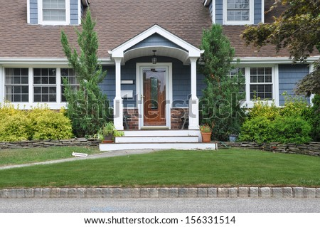 Suburban Home Cape Cod Style Architecture Entrance front Yard USA Residential Neighborhood