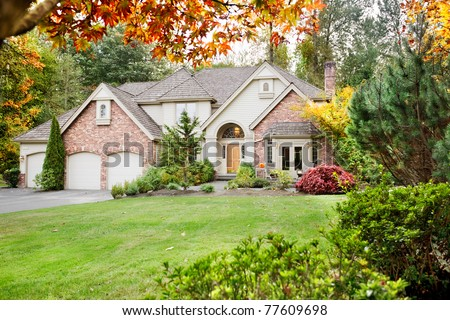 Suburban home in early Autumn as the leaves begin to turn