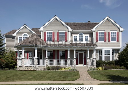 Suburban home with cedar roof and front porch