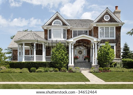 Suburban home with columns and cedar roof