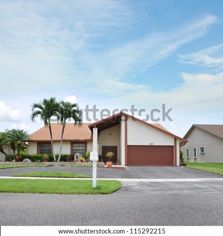 Suburban Home with Palm Trees on residential neighborhood street