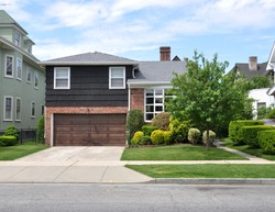 Suburban House Landscaped front yard lawn Residential Neighborhood USA Blue Sky Clouds