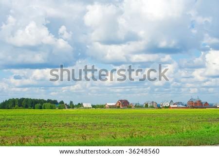Suburban housing development encroaching on farm fields