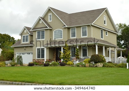 Suburban McMansion style home overcast cloudy day residential neighborhood USA