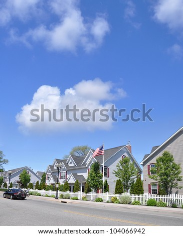 Suburban Neighborhood Street Car Bicycles American Flag Town Homes Sunny Blue Cloud Sky Day