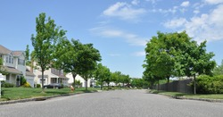 Suburban Neighborhood Street on Sunny Blue Sky Day