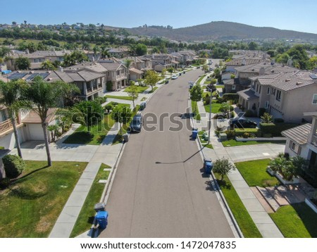 Suburban neighborhood street with big villas next to each other in Black Mountain, San Diego, California, USA. Aerial view of residential modern subdivision luxury house. 08/04/2019 #1472047835