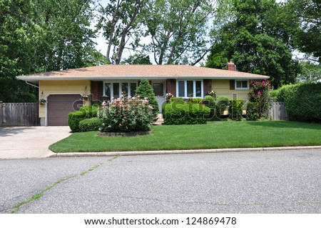 Suburban ranch style home landscaped with flowers and - What is a ranch house ...