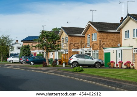 Suburban residential street with modern brick houses.