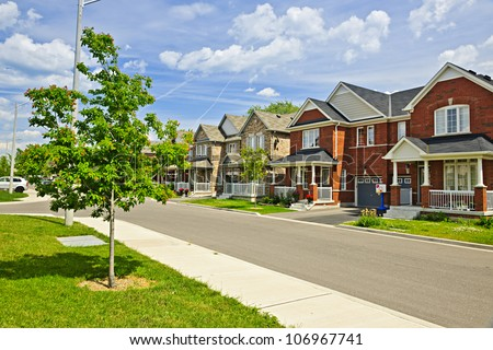 Suburban residential street with red brick houses