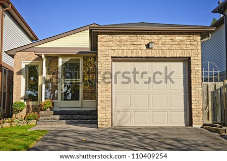 Suburban small bungalow house with single garage