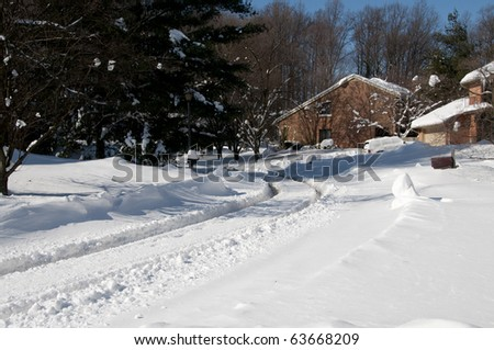 Suburban Street Covered in Fresh Deep Snow on a Sunny Winter Day