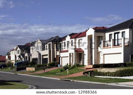 Suburban Street With New Modern Houses In A Sydney Suburb On A Sunny Summer Day, Australia - stock photo