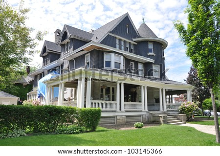 Suburban Three Story Tall Victorian Home Under Repair