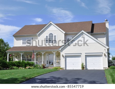 Suburban Two Car Garage Siding Home
