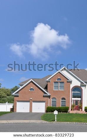 Suburban Two Story Two Car Garage Brick Home Driveway Mailbox