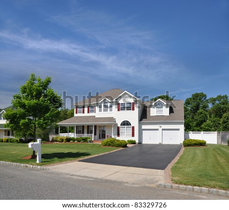 Suburban Two Story Two Car Garage Home Driveway Mailbox