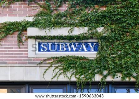 Subway entrance sign in the Bushwick neighborhood of Brooklyn, New York. Stock fotó ©