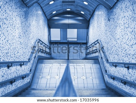 Subway entrance with blank panels, blue toned. - stock photo