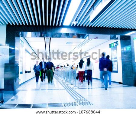 Subway station in Shanghai, China passengers.