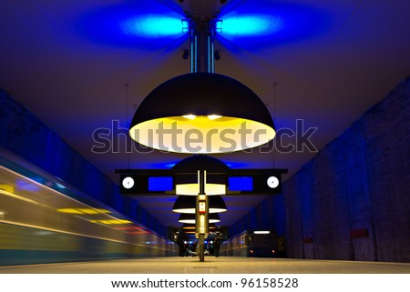 Subway station with incoming trains and symmetric yellow lights