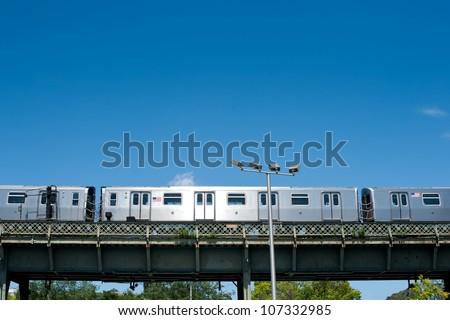 Subway train running outdoors in New York City. #107332985