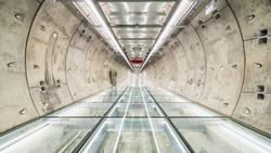 Subway tunnel walkway with no people. Public transportation, construction industry, civil engineering, city life, or futuristic interior design concept