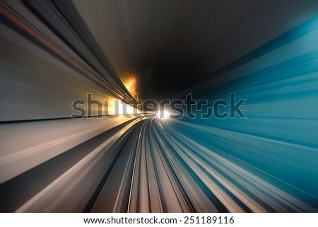 Subway tunnel with blurred light tracks in the gallery - Concept of modern metro underground transport and connection - Radial zoom motion blur due to the speed of the train #251189116