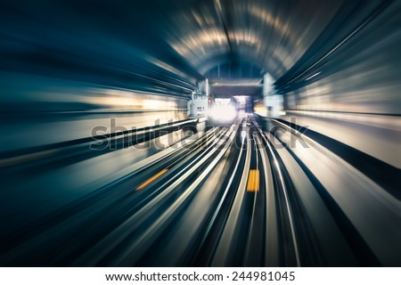 Subway tunnel with blurred light tracks with arriving train in the opposite direction - Concept of modern metro underground transport and connection speed #244981045