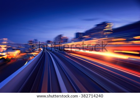 Photo of  Subway tunnel with Motion blur of a city from inside, monorail in Tokyo