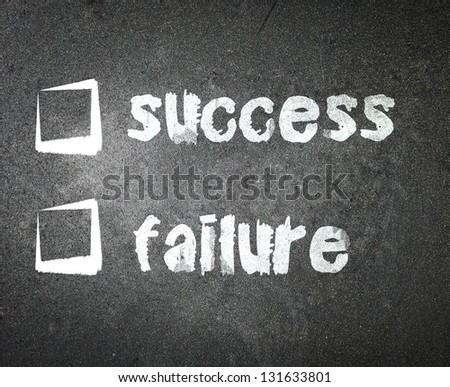 Success and failure handwritten with white chalk on a blackboard with check box