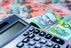 Success and got profit from business with one hundred Australia dollar currency,money and calculator,Focus on eye of a man on banknote,copy space