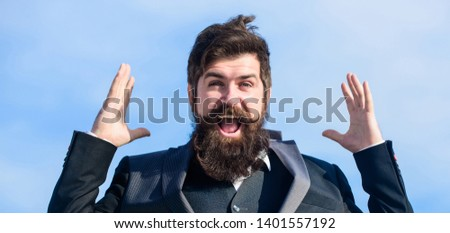Success and luck. Optimistic mood. Think like optimist. Being optimistic. Hopeful and confident about future. Unexpected luck. Man bearded optimistic businessman wear formal suit sky background.