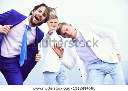 success and meeting, agile business. happy man or bearded businessman and twins guys in business formal outfit with ok and thunb up gesture on light sky background outdoor.